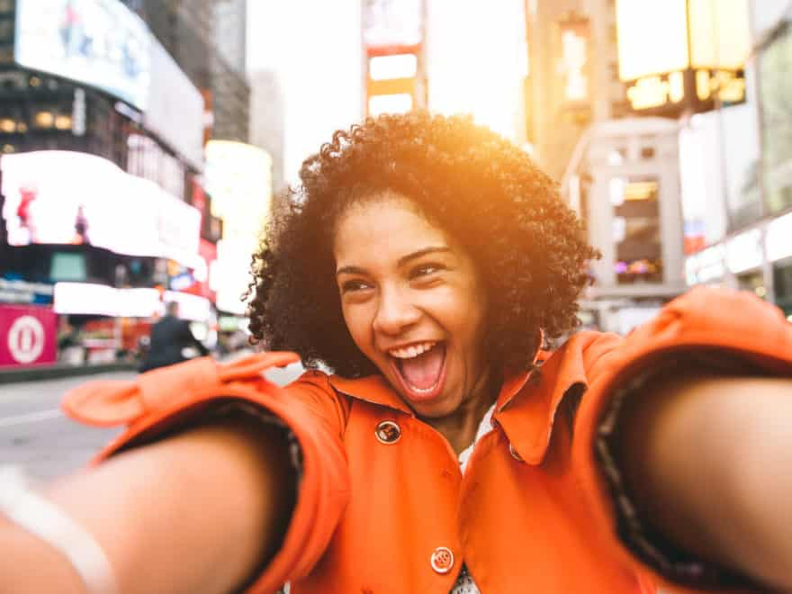 afro american woman taking selfie in Time square, New york. crazy portrait in the famous american square