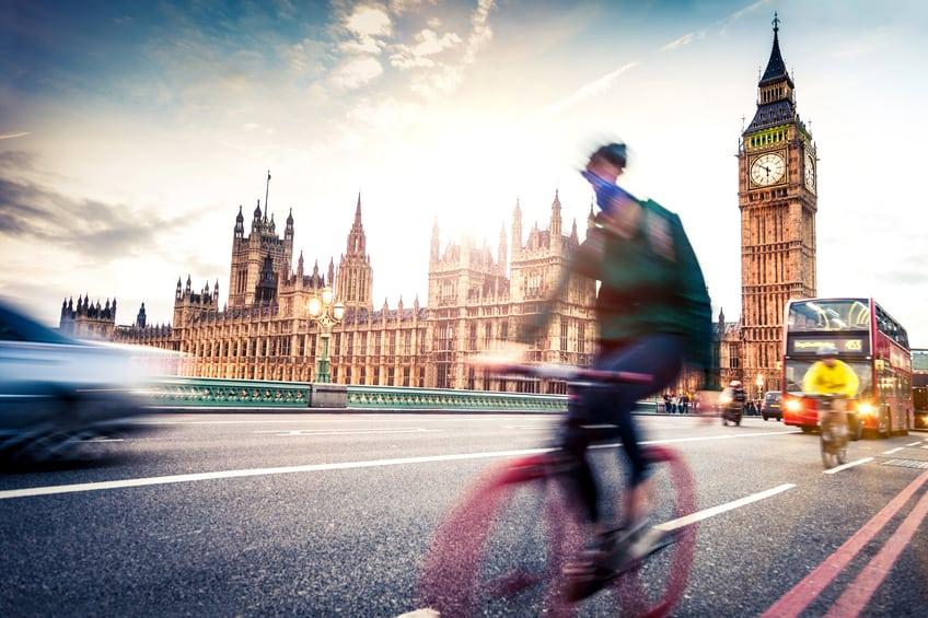 Commuter back home on Westminster Bridge at dusk.